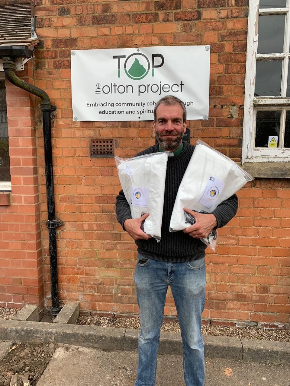 Reverend Dom collecting his mask kits from TOP.